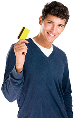 Young man holding a credit card