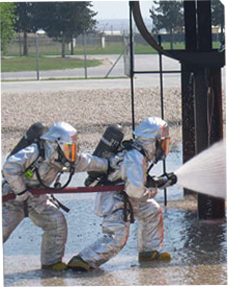 Image of firefighters spraying water