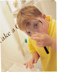 Image of boy with magnifying glass
