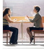 Image of 2 people sitting at a table