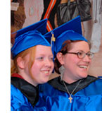 Image of 2 students at commencement