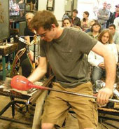 Image of man glass blowing