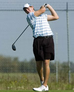 Image of man golfing
