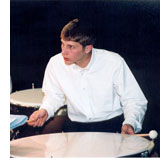 Image of man playing a percussion instrument