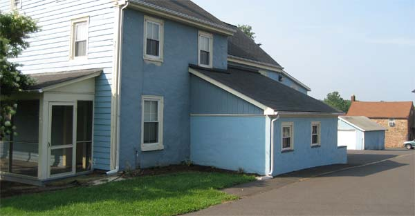 Image of blue house located on campus
