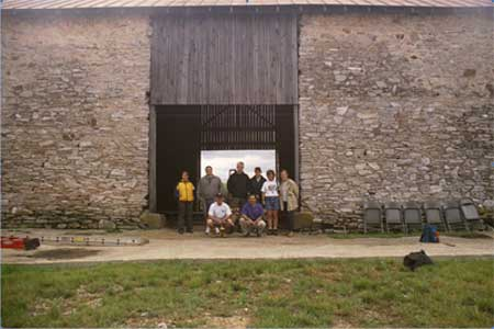 Image of group of people in front of a barn