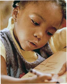 Image of child writing letters