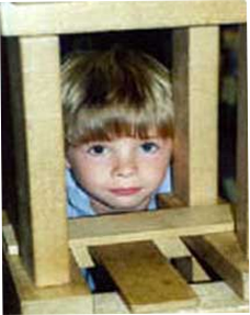 Image of little boy looking through wood square