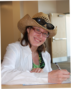 Image of female with hat writing