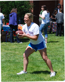 Image of female holding football
